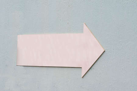 towards: pink elongated arrow on rough bluish background for graphic Stock Photo