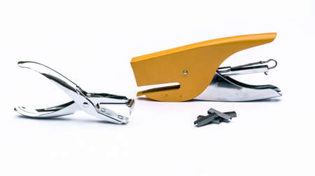 yellow stapler, steel staple remover, metal staple in white background office photo
