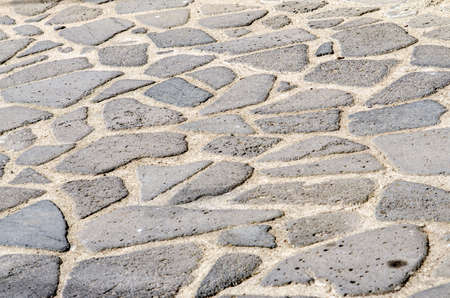 texture of the old cobblestone with rocks of various sizes and types photo