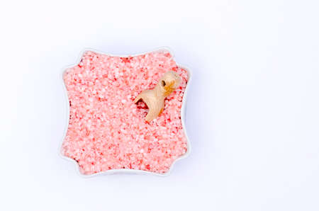 bath salts: bowl full of bath salts with pink and white grains Stock Photo