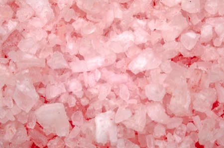bath salts: texture of grains of white and pink bath salts