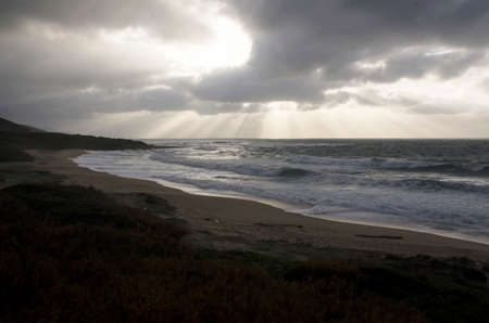 approaching: landscape of rough sea with cloudy sky by storm and burst of light as background