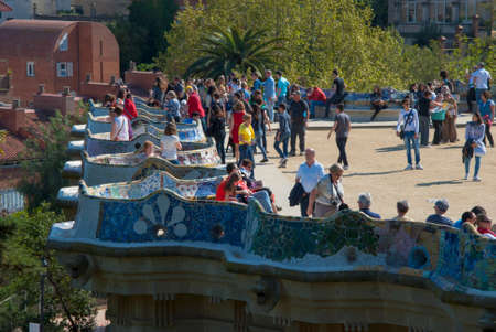 modernisme: Unidentified people at Parc Güell made by Gaudì on April 09.2014 in Barcelona, Spain Editorial