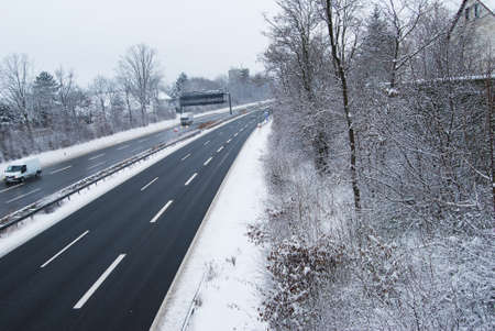 some under 18: Erlangen,  Germany -DECEMBER 18: German highway in winter period under snow with some cars, daily on December 18.2010 in Erlangen, Germany as editorial Editorial