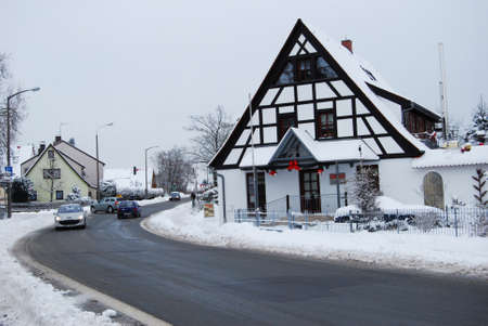 residential street: Erlangen,  Germany -DECEMBER 18: Snow-covered residential street daily in with some cars  on December 18.2010 in Erlangen, Germany  as editorial