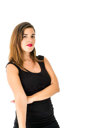 simple girl: Caucasian young girl posing in front of the camera with long hair, black dress and simple make up with release