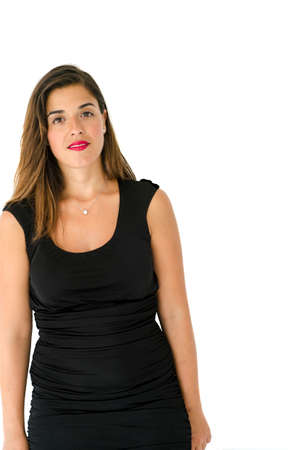 simple girl: Lovely caucasian young girl posing in front of the camera with long hair, black dress and simple make up