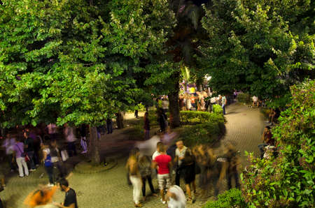 life event: Jerzu, Italy - AUGUST 10: People chatting in a public square with green trees during the festival Calici di stelle. Night scene in top view on August 10.2011 in Jerzu, Italy as editorial Editorial