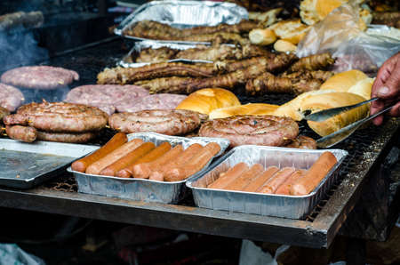 entrails: Typical Sardinian food. Sausages roast, bread, steaks roast, piglets roast and entrails of animals roast, hot dog in a typical sardinian community festival. Aritzo_Autunno in Barbagia