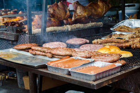 entrails: Typical Sardinian food. Sausages roast, bread, steaks roast, piglets roast and entrails of animals roast, hot dog in a typical sardinian community festival. Aritzo_ Autunno in Barbagia