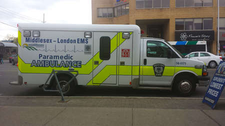 editorial: London Ontario, Canada - May 03, 2016:  ambulance waiting on the Ontario street during the day as editorial