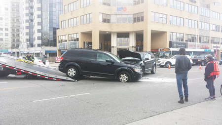 editorial: London Ontario, Canada - May 03, 2016: two destroyed vehicle accident in a crash in the middle of the street as editorial as editorial Editorial