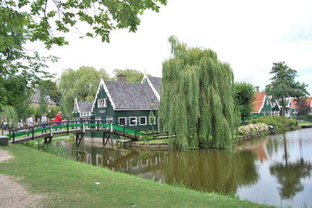 schans: Traditional Dutch old house building in Zaanse Schans - museum village in Zaandam (Traditional village in Holland in Netherlands)