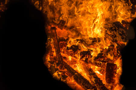 gas fireplace: yellow orange and red fire flames as background with elements burning for creatives Stock Photo