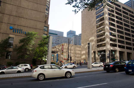 Montreal, Quebec, Canada - 18 July 2016 - Generic street in downtown in Montreal in summertime. Cars, people and buildings as editorial Publikacyjne