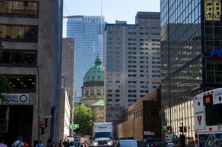 Montreal, Quebec, Canada - 18 July 2016 - Generic building in downtown in Montreal in summertime. Canadian lifestyle with cars, people and skyscapers as editorial