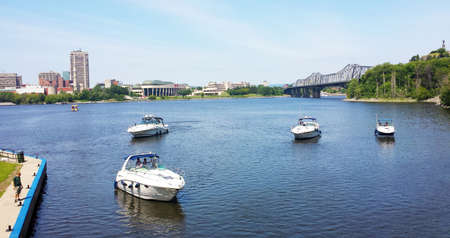 Ottawa, Ontario, Canada - 21 July 2016: Boats in Rideau Canal and the Ottawa River during a sunny summerday as editorial Editöryel