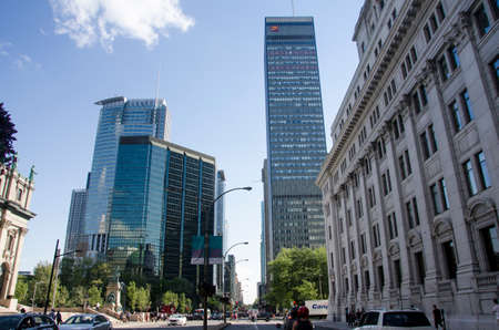 Montreal, Quebec, Canada - 18 July 2016 - Different Syle of buildings (BANK CIBC) in downtown in Montreal in summertime. Canadian lifestyle with cars, people and skyscapers as editorial