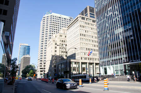 Montreal, Quebec, Canada - 18 July 2016 - Generic street in downtown in Montreal in summertime. Cars, people and and skyscapers as editorial
