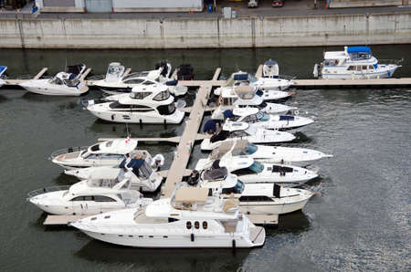 Montreal, Quebec, Canada- July 19 2016: White yachts in the port waiting during summertime. On the sea is calm as editorial