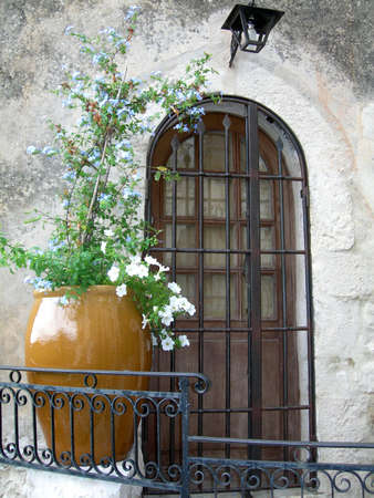 Old house door with ceramic vase