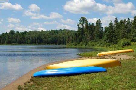 Three kayaks on a beach Stock Photo