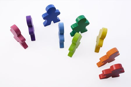 brightly: Workplace Diversity - Brightly colored wooden people standing together.