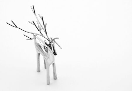 Silver reindeer on a white background.