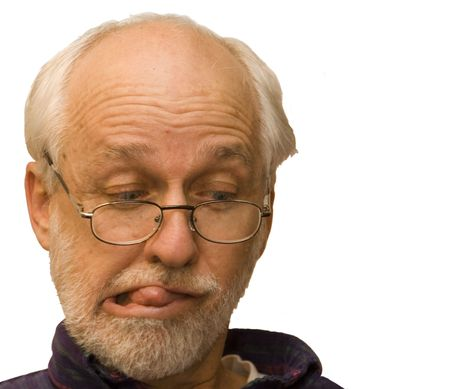 Man making a goofy face isolated on white.