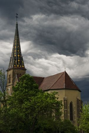 Storm clouds forming over a beautiful church.  Vevy, France. photo