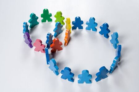 Multicolored wooden people illustrating a business concept - networking or teamwork. Stock Photo