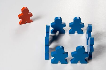 Multicolored wooden people illustrating a business concept. Stock Photo
