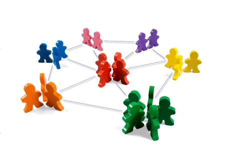 Business concepts illustrated with colorful wooden people - networking, organizational groups, or workgroups. Stock Photo