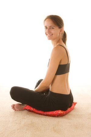 yoga pillows: Beautiful young woman wearing workout clothes.