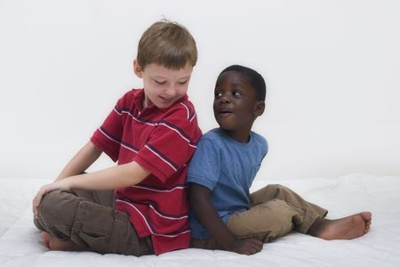 foster: Two young boys of different races playing together. Stock Photo