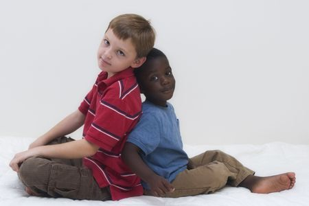Two young boys of different races playing together. Stock Photo - 536563