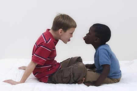 Two young boys of different races playing together. Stock Photo - 536564