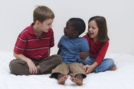 Two young boys of different races playing together. Stock Photo