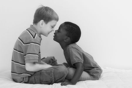 Two young boys of different races playing together. photo