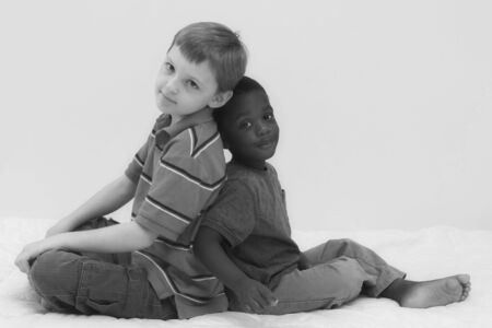 Two young boys of different races playing together. Stock Photo - 545554
