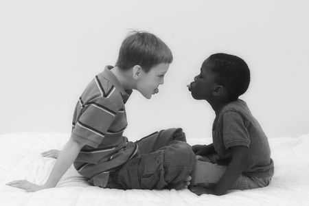 Two young boys of different races playing together. Stock Photo - 545555