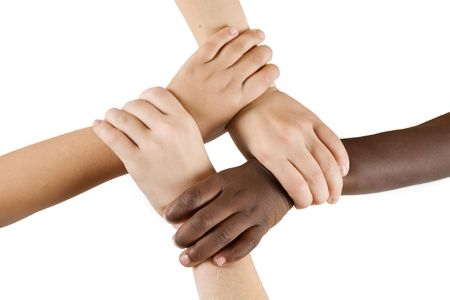 diverse hands: Diversity Series - Four children linking hands. Stock Photo