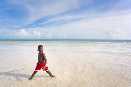 A young boy playing in the water at the beach. Bahia Honda, Florida Keys.
