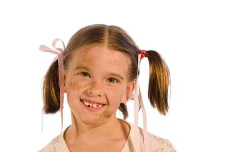 Very dirty young girl smiling - pink ribbons in her hair. Studio shot isolated on a white background.
