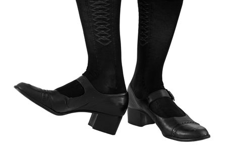 tap dance: Tapping her toes. Black leather dress shoes and fancy stockings iosolated on a white background. Stock Photo
