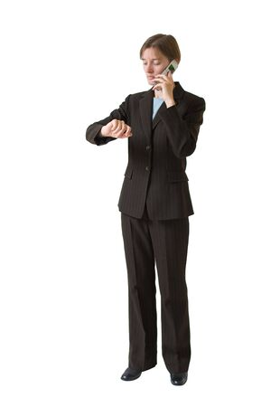 Young business woman in a tailored suit with cell phone. Image is isolated on a white background. Stock Photo - 980780