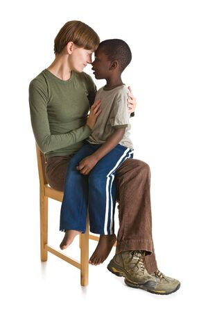 A young African-American boy with a Caucasian woman. Isolated on white.