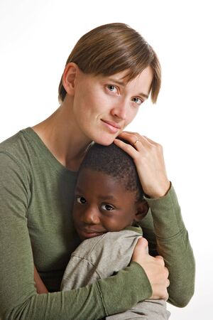 A young African-American boy with a Caucasian woman. Isolated on white. photo