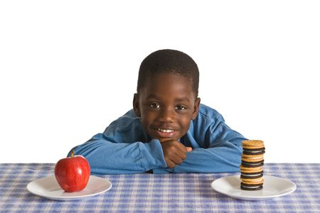 A young African-American boy with snack - studio shot isolated on white.