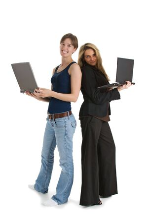 informal clothing: Two young business women with laptop computers - one wearing casual clothes and the other dressed in a suit.  Isolated on white background.